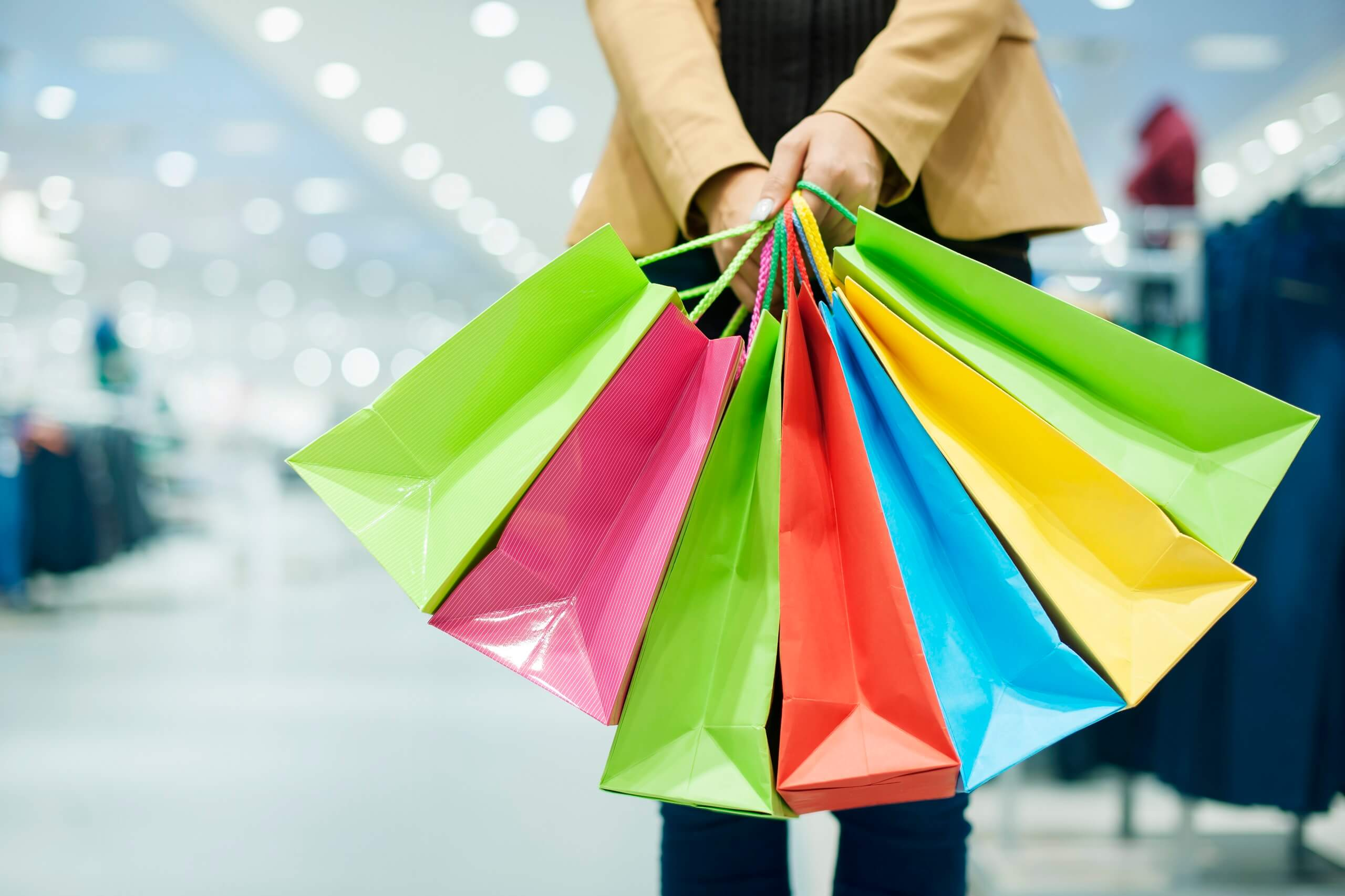 Woman holding colorful shopping bags in a department store
